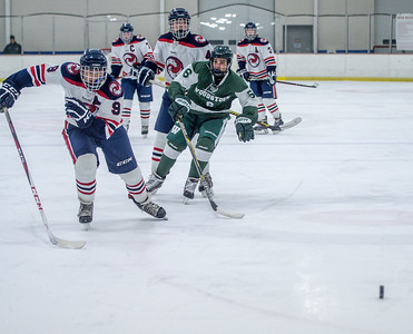 Michael Cimis chases down the puck in the Hartford zone