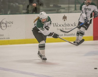 Khara Brettell passes the puck