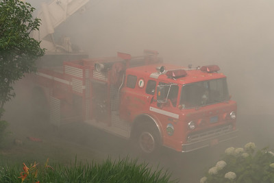 3 West Windsor's ladder truck is swallowed by the smoke as it operates on High Street at the rear of the fire building