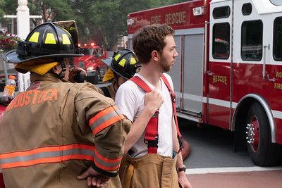 28 Woodstock volunteer firefighter Ward Goodenough (center) keeps an eye on the fire scene