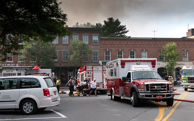 23 EMTs rush a firefighter who was suffering from heat exhaustion to a waiting Woodstock Ambulance