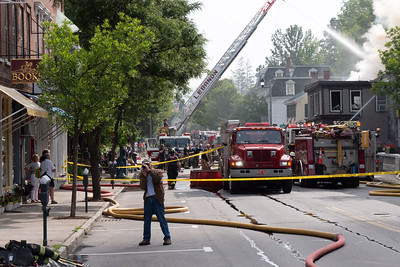 20 Intrepid publisher Phil Camp photographs the fire scene downtown