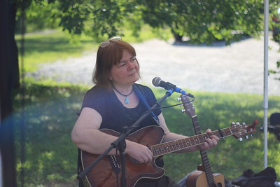 Bonnie Waters plays guitar and sings