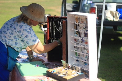 Lois Warren, of Springfield, arranges jewelry in her booth at the Hartland Farmers Market