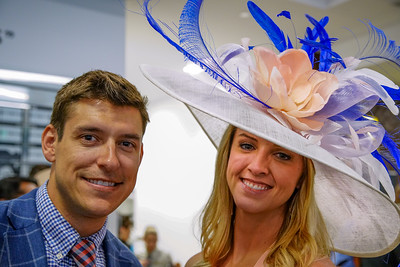 A couple enjoying The Turf Club. Derby Hat at  The 144th Running Of The Kentucky Derby