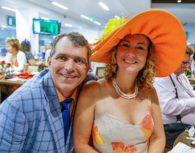 A couple enjoying The Turf Club at  The 144th Running Of The Kentucky Derby