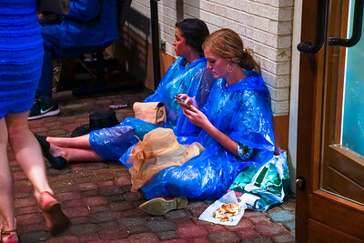 Ladies waiting out the rain  at The Kentucky Derby