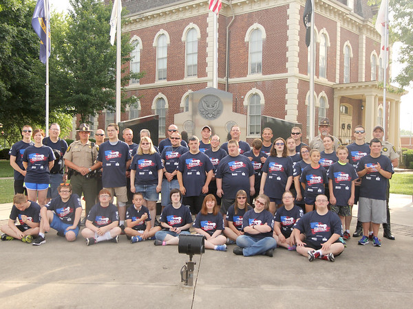 The participants in the 16th leg of the Special Olympic's Law Enforcement Torch Run pose Wednesday morning in downtown Effingham. The event raises awareness and money for the Special Olympics. The state competitions begin on Friday. Graham Milldrum photo