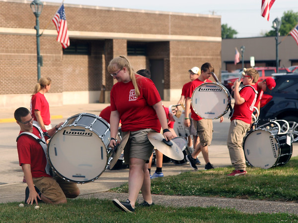 Members of the Marshall High School Band Drum Line prepare ahead of the 16th leg of the Special Olympic's Law Enforcement Torch Run started Wednesday morning in downtown Effingham. The event raises awareness and money for the Special Olympics. The state competitions begin on Friday. Graham Milldrum photo