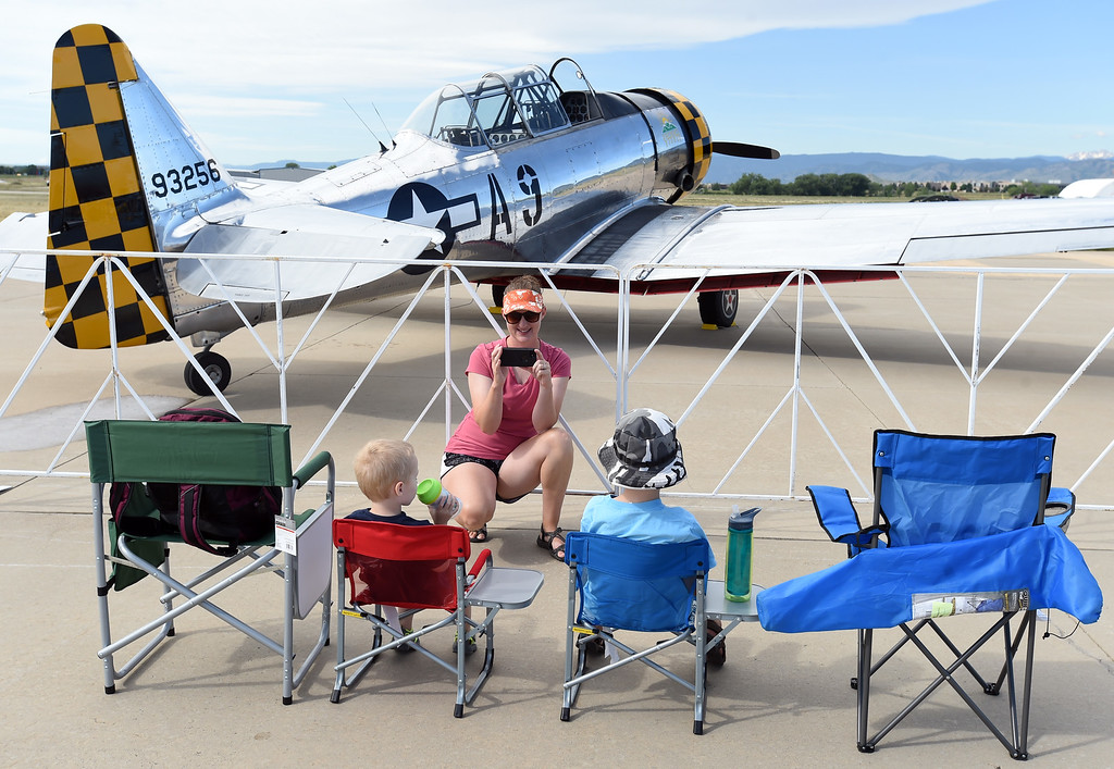 . Felicia Clifford photographs her sons, Liam and Ethan, during the 2018 Longmont Airport Expo at Vance Brand Airport on Saturday. For more photos, go to dailycamera.com. Cliff Grassmick  Staff Photographer  June 23, 2018