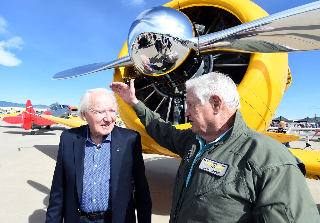 . Former astronaut, Vance Brand, left,  the airport�s namesake, born in Longmont, talks to  pilot, Jack Cronin,  during the 2018 Longmont Airport Expo at Vance Brand Airport on Saturday. Brand learned to fly in a similar aircraft, shown in the background.  For more photos, go to dailycamera.com. Cliff Grassmick  Staff Photographer  June 23, 2018