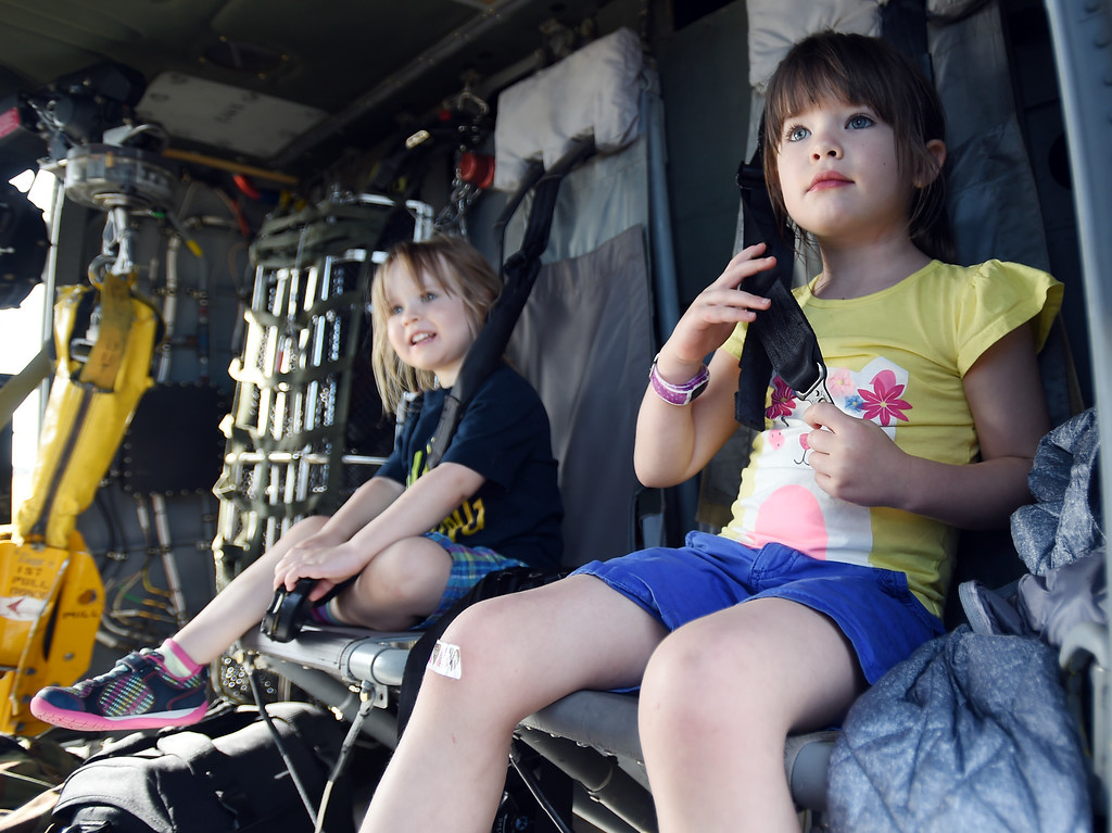 . Julia Cabell, left, and her sister, Lily, test out the seats of a blackhawk helicopter during the 2018 Longmont Airport Expo at Vance Brand Airport on Saturday. For more photos, go to dailycamera.com. Cliff Grassmick  Staff Photographer  June 23, 2018