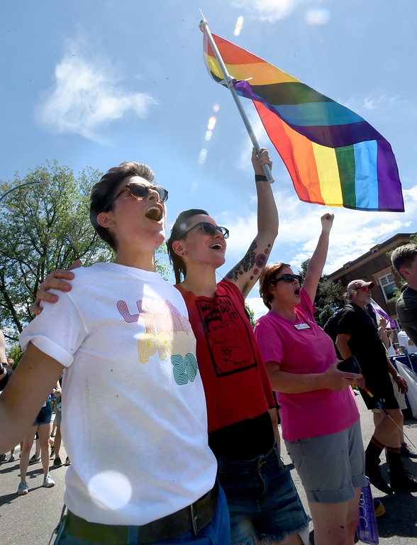 . Messa and Michal Duffy cheer on the speakers during the 2018 Longmont Pride celebration on Saturday. For more photos, go to dailycamera.com. Cliff Grassmick  Staff Photographer  June 23, 2018