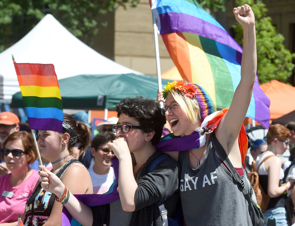 . Alani Rusillo, left, and Lindsay Graves, cheer on speakers during the 2018 Longmont Pride celebration on Saturday. For more photos, go to dailycamera.com. Cliff Grassmick  Staff Photographer  June 23, 2018