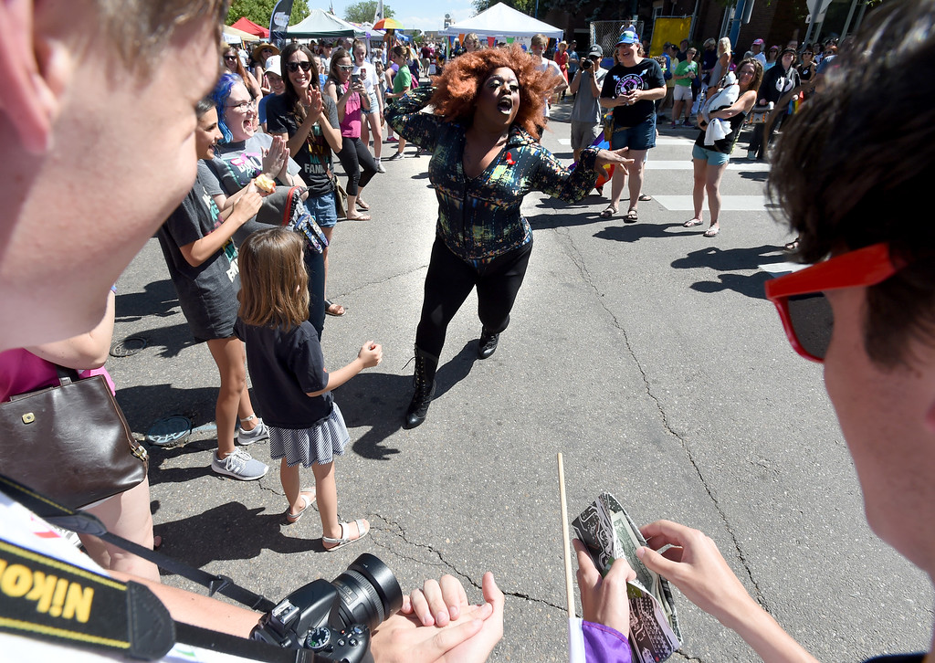 . Porsha DeMarco Douglas finishes  her high energy dance routine during the 2018 Longmont Pride celebration on Saturday. For more photos, go to dailycamera.com. Cliff Grassmick  Staff Photographer  June 23, 2018