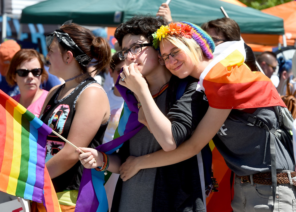 . Alani Rusillo, left, and Lindsay Graves, hug while listening to speakers during the 2018 Longmont Pride celebration on Saturday. For more photos, go to dailycamera.com. Cliff Grassmick  Staff Photographer  June 23, 2018