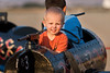 Jayce Proctor, 2 1/2 years, from Yerington, rides in a rocket ship in the carnival area.