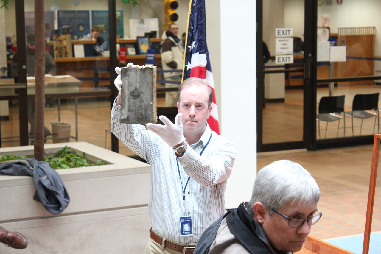 Charles Pritchard - Oneida Daily Dispatch Madison County officials unearth a time capsule from the county courthouse on Monday, April 16, 2018. The time capsule was sealed behind the cornerstone of the building on Jan. 7, 1909, and was removed while the courthouse undergoes renovation.