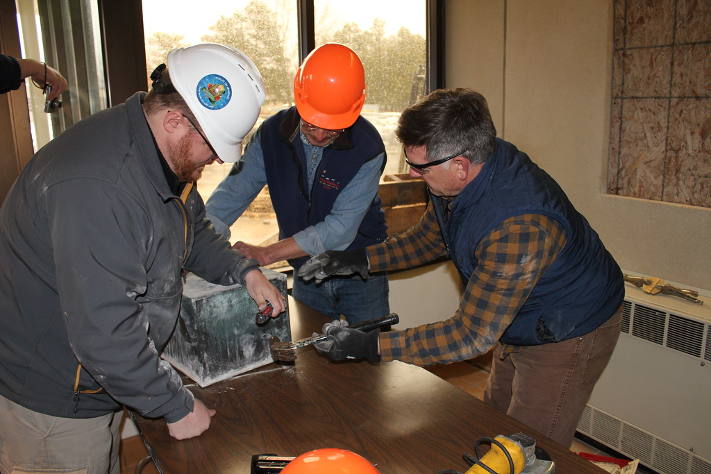 . Charles Pritchard - Oneida Daily Dispatch Madison County officials unearth a time capsule from the county courthouse on Monday, April 16, 2018. The time capsule was sealed behind the cornerstone of the building on Jan. 7, 1909, and was removed while the courthouse undergoes renovation.