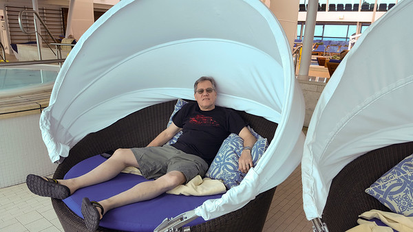 Joe in basket chair next to one of the hot tubs