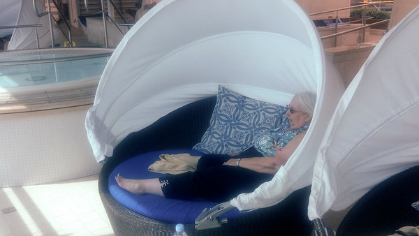Lynn in basket chair in the solarium