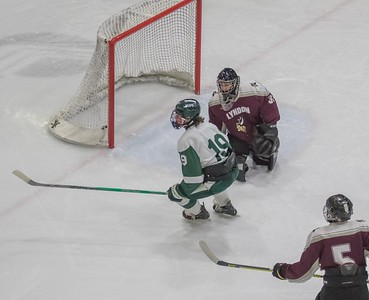 Tom Bissaillon shoots one into the net