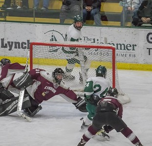 Owen Coats slips a rebound past the Lyndon goalie