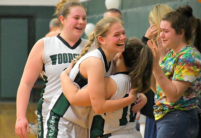 DSC_5285 emma walker and brook heston, get hugs and hi fives as they leave game near end