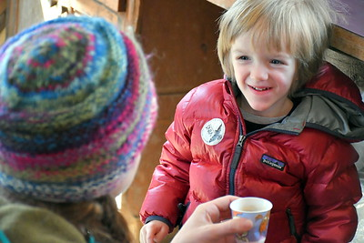 DSC_1557 Hunter Feinberg,3, and his mom Emily,,of killington,,syrup still hot from the evaporator