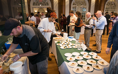 Chef Jeremy Conaway (left) and Line Cook Antonio Centonze of Simon Pearce Restaurant in Quechee prepare samples of puff pastry topped with lamb shoulder that was roasted in hay, served with minty peas