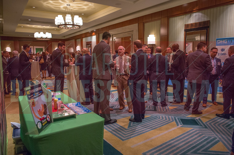 Attendees of the CBJ Middle Market Leaders event network before enjoying dinner and an awards ceremony.