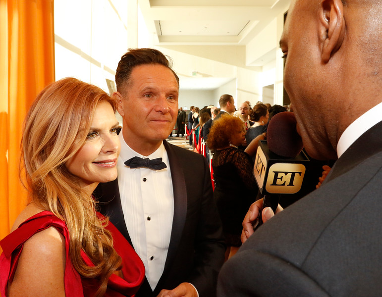 "Actress Roma Downey, left, and Mark Burnett talks with ET's Kevin Frazier on the red carpet at the Minnie's Food Pantry 10th Annual Feed Just One Gala on Tuesday evening, April 3, 2018, at the Omni Frisco Hotel in Frisco, Tx. Downey and Burnett were presented the Minnie Ewing Legacy Award.<br /> Oprah Winfrey was the keynote speaker, with special guest  Floyd Mayweather, NFL Hall of Famer Emmitt Smith, Joel and Victoria Osteen, Actress Roma Downey and Mark Burnett, GRAMMY winner recording artists, Israel Houghton, and Donnie McClurkin. ET's Kevin Frazier was the emcee of the event. Minnie's Food Pantry's has distributed over 7 million meals to families in needs and is 100% community funded.  <a href=""http://www.minniesfoodpantry.org"">http://www.minniesfoodpantry.org</a>"