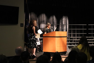 Eighth-grade student Diana McLean welcomes the crowd.