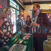 UNC-Charlotte's Belk School of Business table at the NextGen panel discussion on Cross-Generational Colleagues, held at Olde Mecklenburg Brewery.