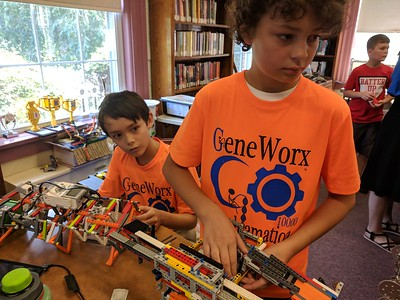 Leah McDonald - Oneida Daily Dispatch Gabriel Stone, 11, right, and Roland Kohler, 11, talk about their Lego robots on Friday, Aug. 24, 2018, at the Oneida Public Library.