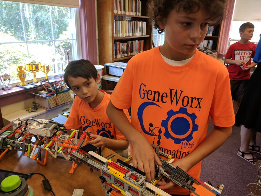 . Leah McDonald - Oneida Daily Dispatch Gabriel Stone, 11, right, and Roland Kohler, 11, talk about their Lego robots on Friday, Aug. 24, 2018, at the Oneida Public Library.