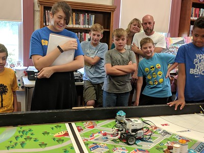 Leah McDonald - Oneida Daily Dispatch Team Super Bot's Lego robot makes its way across the table during the Oneida Public Library's Lego robotics summer camp on Friday, Aug. 24, 2018.