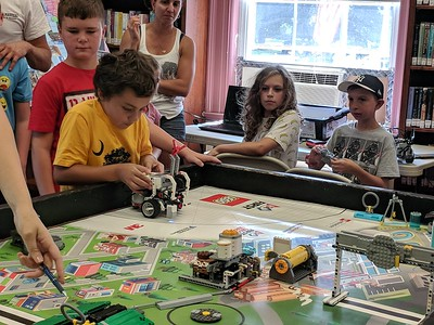 Leah McDonald - Oneida Daily Dispatch Team Goofball's Sullivan Krol, 10, sets his robot's commands during the Oneida Public Library's Lego robotics summer camp on Friday, Aug. 24, 2018.
