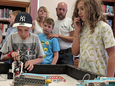 Leah McDonald - Oneida Daily Dispatch Team Batbot's Jackson Krol, 12, right, and Jacob Higgins, 10, take part in the Oneida Public Library's Lego robotics summer camp on Friday, Aug. 24, 2018.