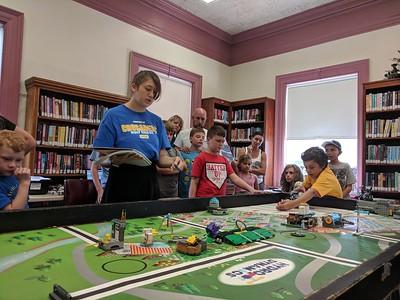 Leah McDonald - Oneida Daily Dispatch Team Goofball's Robbi Davis, 11, left, and Sullivan Krol, 10, take part in the Oneida Public Library's Lego robotics summer camp on Friday, Aug. 24, 2018.