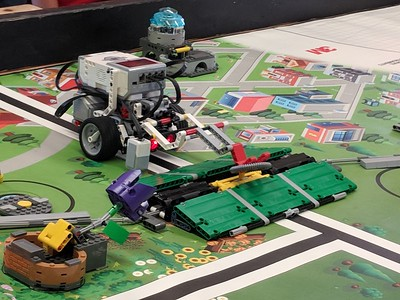 Leah McDonald - Oneida Daily Dispatch Team Goofball's Lego robot tries to lift a pipe during the Oneida Public Library's Lego robotics summer camp on Friday, Aug. 24, 2018.