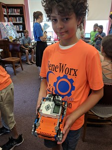 Leah McDonald - Oneida Daily Dispatch Gabriel Stone, 11, shows off a Lego robot that won first place at a recent Robot Riot competition.