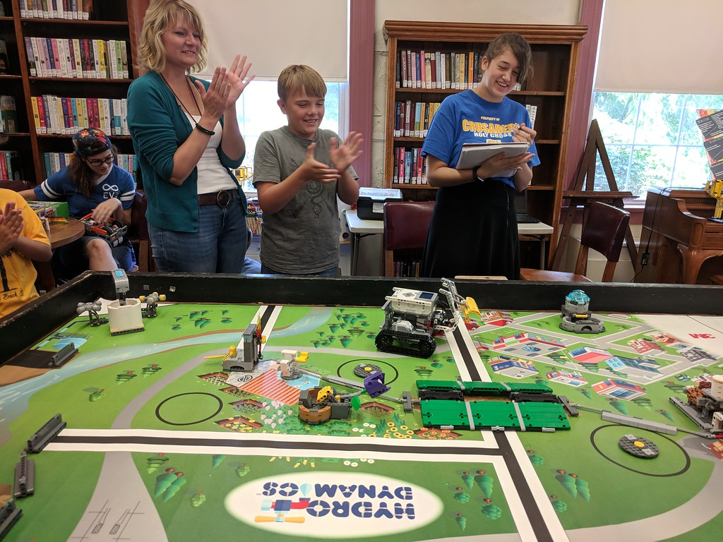 . Leah McDonald - Oneida Daily Dispatch Team Pitchfork\'s Lego robot carries a pipe back toward base during the Oneida Public Library\'s Lego robotics summer camp on Friday, Aug. 24, 2018.