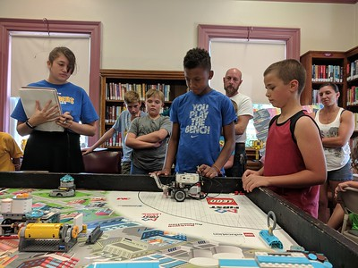 Leah McDonald - Oneida Daily Dispatch Team Super Bot's Daunte Bocheyie, 11, left, and Tyson Fuller, 11, take part in the Oneida Public Library's Lego robotics summer camp on Friday, Aug. 24, 2018.