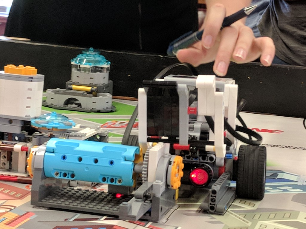 . Leah McDonald - Oneida Daily Dispatch Team Super Bot\'s Lego robot moves a lever into place during the Oneida Public Library\'s Lego robotics summer camp on Friday, Aug. 24, 2018.