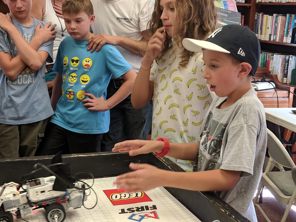 . Leah McDonald - Oneida Daily Dispatch Team Batbot\'s Jackson Krol, 12, left, and Jacob Higgins, 10, take part in the Oneida Public Library\'s Lego robotics summer camp on Friday, Aug. 24, 2018.