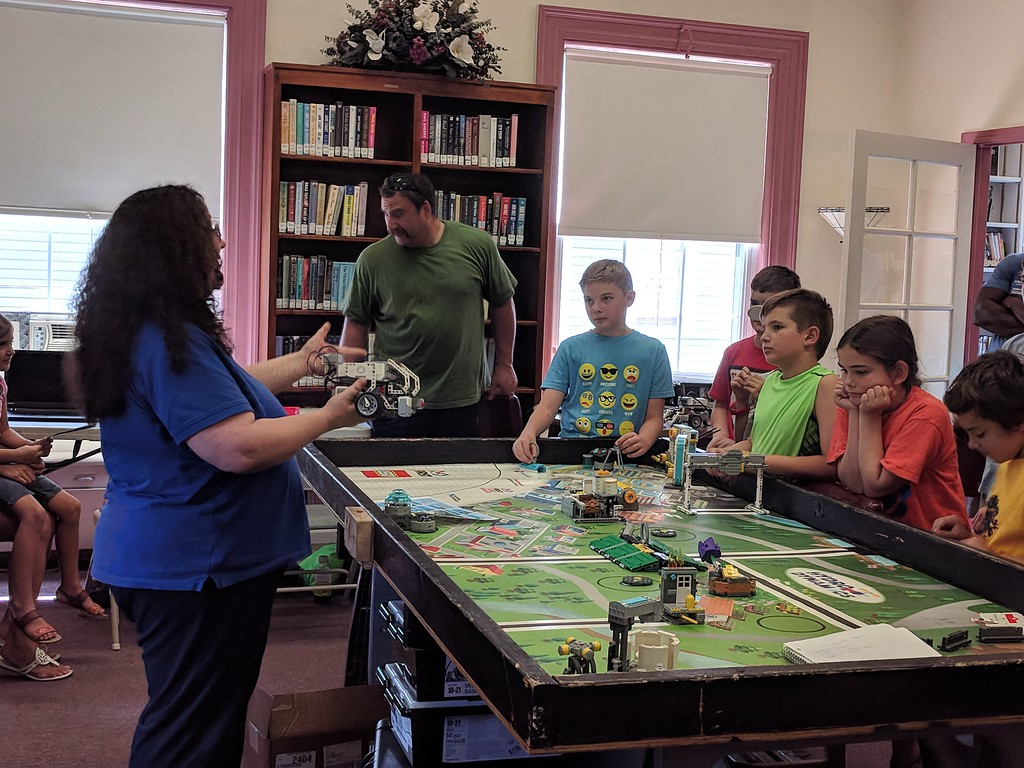 . Leah McDonald - Oneida Daily Dispatch Coach Tandi Pough explains how students program and build their Lego robots at the Oneida Public Library on Friday, Aug. 24, 2018.