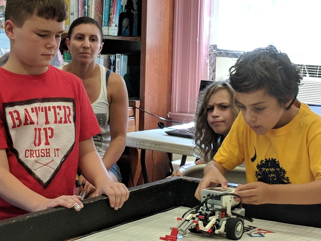 . Leah McDonald - Oneida Daily Dispatch Team Goofball\'s Robbi Davis, 11, left, and Sullivan Krol, 10, take part in the Oneida Public Library\'s Lego robotics summer camp on Friday, Aug. 24, 2018.