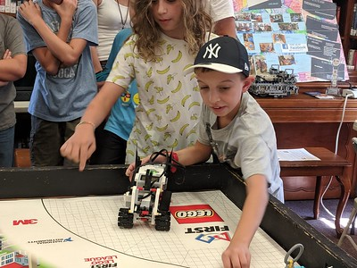 Leah McDonald - Oneida Daily Dispatch Team Batbot's Jackson Krol, 12, left, and Jacob Higgins, 10, take part in the Oneida Public Library's Lego robotics summer camp on Friday, Aug. 24, 2018.
