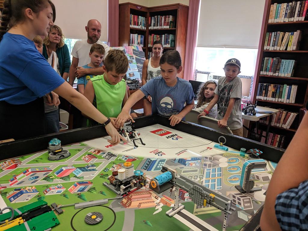 . Leah McDonald - Oneida Daily Dispatch Team Chocolate Bunny Rabbits\' Kai Jones, 10, and Irene Barris, 9, take part in the Oneida Public Library\'s Lego robotics summer camp on Friday, Aug. 24, 2018.